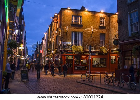 DUBLIN, IRELAND- NOVEMBER 13: People at night in the Temple Bar district in Dublin on november 13, 2007. The Temple bar district is worldfamous for its pubs and other nightlife entertainment  - stock photo