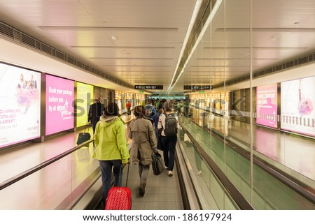 DUBLIN - JULY 21, 2013: Passengers walking towards the gates. Almost 2.2 million passengers travel through Dublin Airport in July, a 7% increase over the same period last year. - stock photo