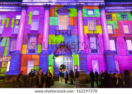 DUBLIN - OCTOBER 30: Failte Ireland works with Trinity College and the IDA to develop high impact light projections on the facade of Trinity College and Bank of Ireland on October 30, 2013 in Dublin - stock photo