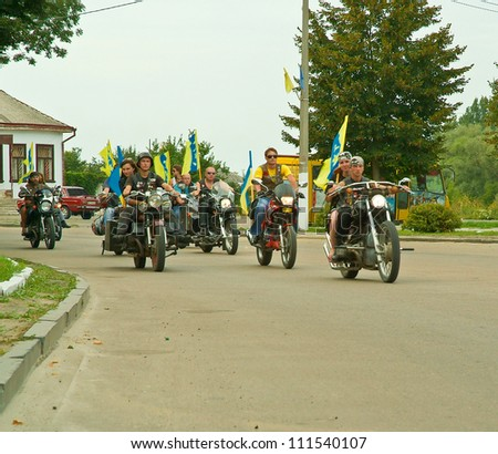 DUBNO, UKRAINE -  AUGUST 25: Unidentified bikers ride their motorcycles during celebration of Ukraine independence day and Dubno city (Ruvno area) day on August 25, 2012 in Dubno, Ukraine.