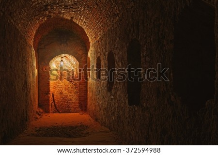DUBNO, UKRAINE - JULY 22, 2012: Well lit catacombs of the castle in Dubno, Ukraine  - stock photo