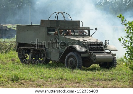 DUBOSEKOVO, RUSSIA - JULY 13: M3 half-track APC stands on the field during Field of Battle military history festival on July 13, 2013 in Dubosekovo, Russia