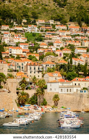 DUBROVNIK, CROATIA - AUG 21, 2014: Boats at the harbour of the Old town of Dubrovnik, Croatia. Dubrovnik is a UNESCO World Heritage site