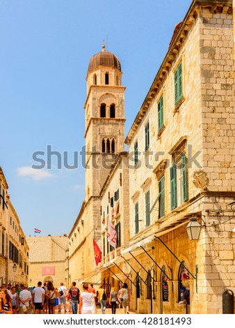 DUBROVNIK, CROATIA - AUG 21, 2014: Unidentified tourists on the Stradun street of the  Old town of Dubrovnik, Croatia. Dubrovnik is a UNESCO World Heritage site