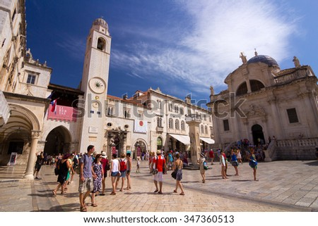 Dubrovnik, Croatia-August 24, 20214: A group of tourists in front of St. Blaise Church (Crkva sv. Vlaha) and belfry in old town of Dubrovnik, Croatia