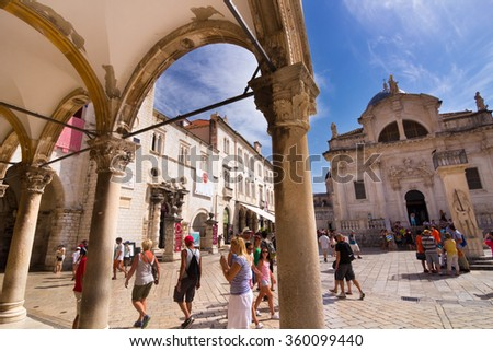 Dubrovnik, Croatia-August 24, 2014: A group of tourists on main street (Stradun) in front of the Church of Saint Blaise (Sv. Vlaho) in old town of Dubrovnik, Croatia - stock photo