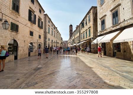 Dubrovnik, Croatia-August 24, 20214: A group of tourists on main street (Stradun) in old town of Dubrovnik, Croatia - stock photo