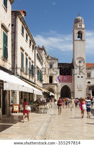 Dubrovnik, Croatia-August 24, 2014: A group of tourists on main street (Stradun) in old town of Dubrovnik, Croatia - stock photo