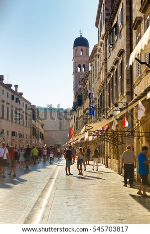 Dubrovnik, Croatia-August 15, 2016: A group of tourists on main street (Stradun) in old town of Dubrovnik, Croatia