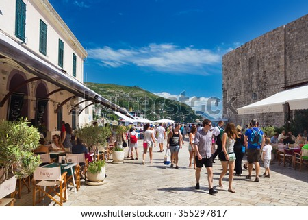 Dubrovnik, Croatia-August 24, 2014: A group of tourists walking in Old Port, Dubrovnik, Croatia