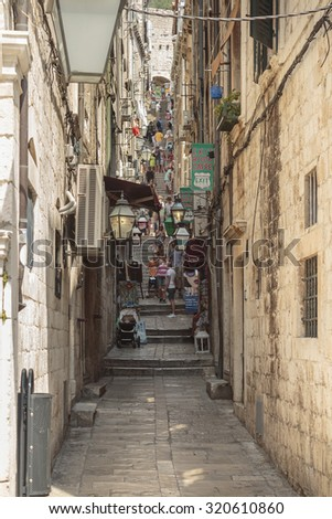 DUBROVNIK, CROATIA - AUGUST 13, 2015: Summer scene of the narrow Buza street that leads to the cable car