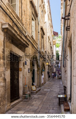 Dubrovnik, Croatia-August 24, 20214: Tourists walking on picturesque narrow street in old town of Dubrovnik, Croatia - stock photo