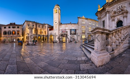 DUBROVNIK, CROATIA - JUNE 30, 2014: Panorama of Luza Square and Sponza Palace in Dubrovnik.  In 1979, the city of Dubrovnik joined the UNESCO list of World Heritage Sites.
