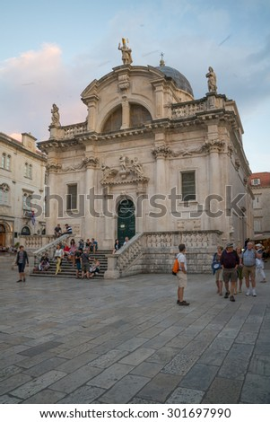 DUBROVNIK, CROATIA - JUNE 26, 2015: Sunset scene of St. Blaise Church, with locals and tourists, in Dubrovnik, Croatia