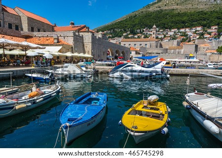 Dubrovnik, Croatia - June 12th 2016 - Boats anchored inside the medieval city of Dubrovnik in a late afternoon in summer. Croatia, Europe.