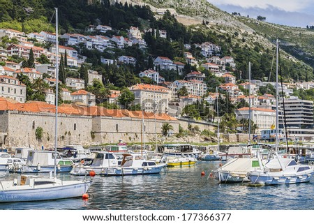 DUBROVNIK, CROATIA - MAY 5, 2012: Boats moored in Old Port in eastern part of the Old Town of Dubrovnik. Dubrovnik - UNESCO World Heritage Site. Croatia, Europe.