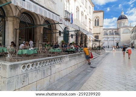 DUBROVNIK, CROATIA - MAY 28, 2014: Guests sitting at terrace of Gradska kavana, famous coffee location in the old town. - stock photo