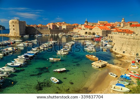 Dubrovnik fortress panorama and harbor with boats and luxury yachts,Dalmatia,Croatia,Europe - stock photo