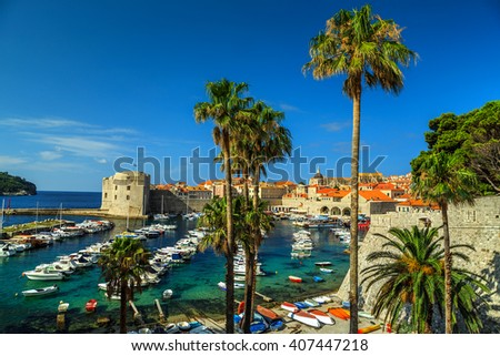 Dubrovnik fortress panorama and harbor with colorful boats and luxury yachts,Dalmatia,Croatia,Europe - stock photo