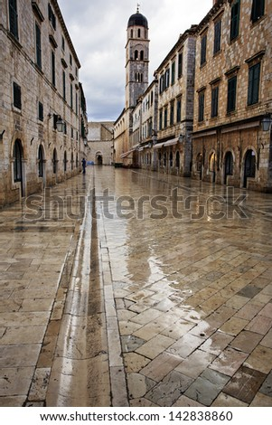 Dubrovnik in the dawn rain with beautiful reflections - stock photo