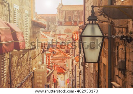 Dubrovnik old city street view, Croatia, warm filter, lens flare - stock photo