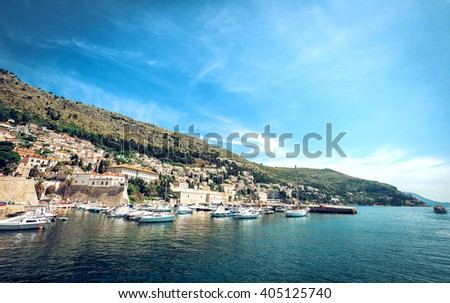 Dubrovnik old medieval harbor in bay. Croatia. - stock photo