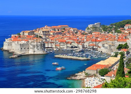 Dubrovnik old town with small boats inside Western harbor, Croatia