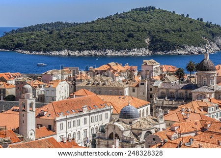 Dubrovnik panorama with traditional Mediterranean medieval houses with red tiled roofs. Dubrovnik on Adriatic Sea is one of most prominent tourist destinations, UNESCO World Heritage Site. Croatia. - stock photo