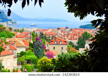 Dubrovnik - view of the old town through the trees - stock photo