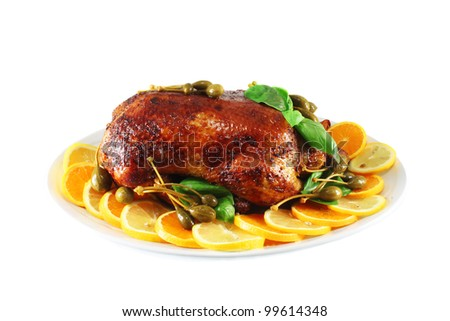 Duck baked in the oven with orange, lemon, capers and basil