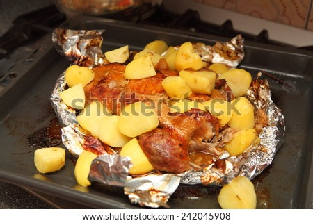 duck baked with apples and oranges in foil - stock photo