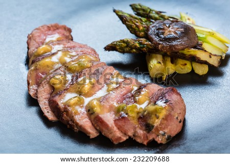 Duck breast on orange sauce with vegetable. Japanese cuisine. selective focus