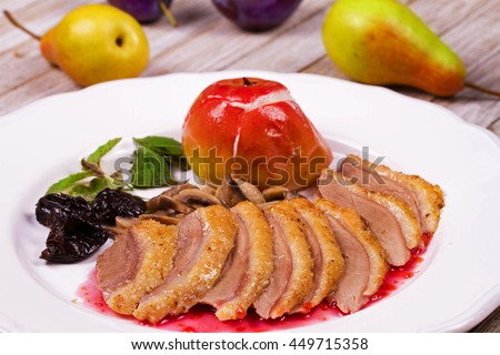 Duck breast with apple, smoked plums, mushrooms and basil in red wine sauce