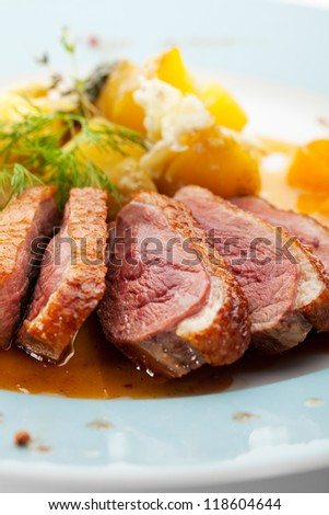 Duck Breast with Orange and Potato - stock photo