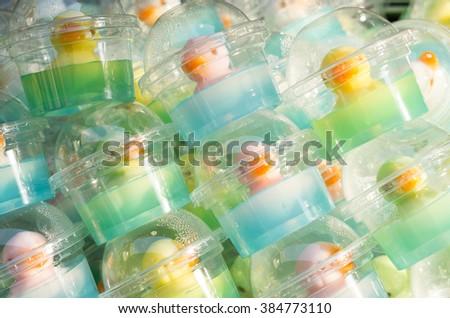 Duck jelly in plastic glass, white duck coconut jelly in blue jelly, pink duck coconut jelly,yellow duck coconut jelly in green jelly , white duck coconut jelly, delicious dessert,duck food,gelatin,  - stock photo