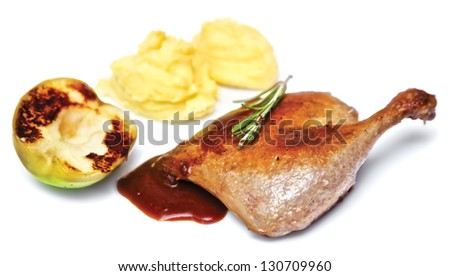 Duck leg baked with apple and mashed potatoes - stock photo
