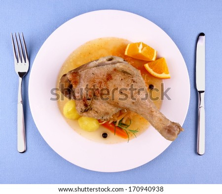 Duck leg with braised cabbage, potato and gravy, top view - stock photo