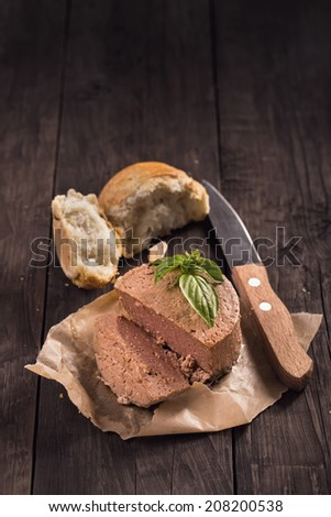 Duck liver pate with bread and basil rustic style still-life - stock photo