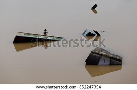 duck on a moored boat on the flooded river