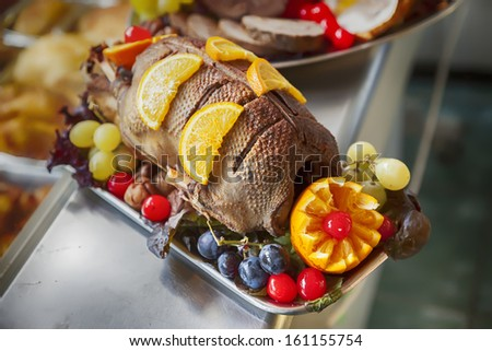 Duck  on plate in poultry shop  - stock photo