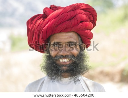 DUDANI, INDIA - SEPTEMBER 09: a rural man of rebari costom wearing colorful turban & casual and agree to pose at annual festival of rebari comunity on September 09 2016 in Dudani, Rajasthan, india