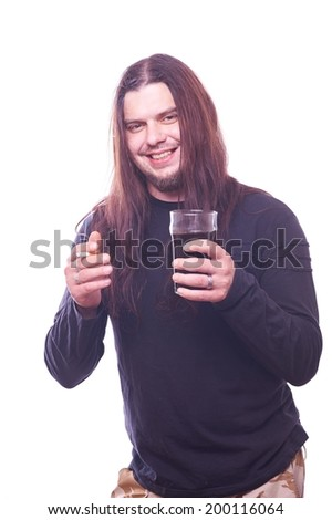 Dude with flowing hair holding cigaret and beer glass, studio shot - stock photo