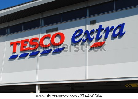 Dudley - Apr 26: View of a Tesco logo on the outside of a Extra store on Apr 26th, 2015 in Dudley, UK. Tesco has announced the closure of 43 stores in the UK after reporting massive financial losses.