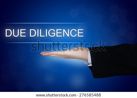 Due diligence button with business hand on blue background - stock photo