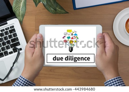 due diligence  man hand Tablet and coffee cup - stock photo