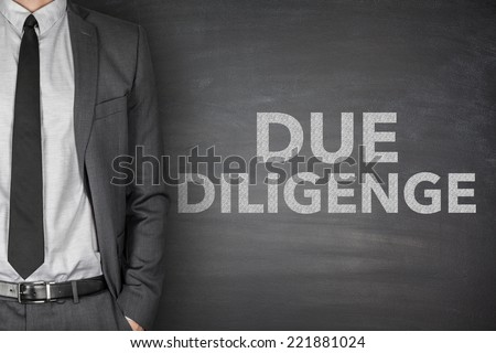 Due diligence on black blackboard with businessman - stock photo