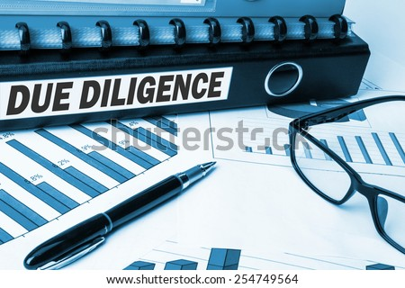 due diligence on business document file - stock photo