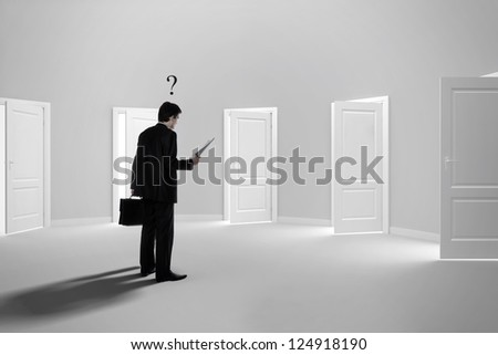 Due to bureaucracy.Make a decision. Choose a job. Be interviewed. Recruitment. Achieving the goal. Cease to be unemployed. With question above the head. Open doors. - stock photo