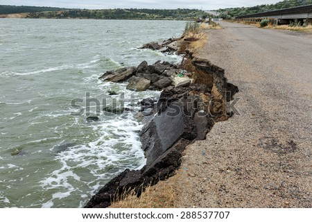 Due to violations of technology in the construction of roads, water, more rain and huge waves of the sea during a storm split and broke and washed away the asphalt road and formed a landslide failure