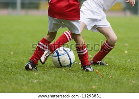 Duel of football players. Focus on the ball. - stock photo